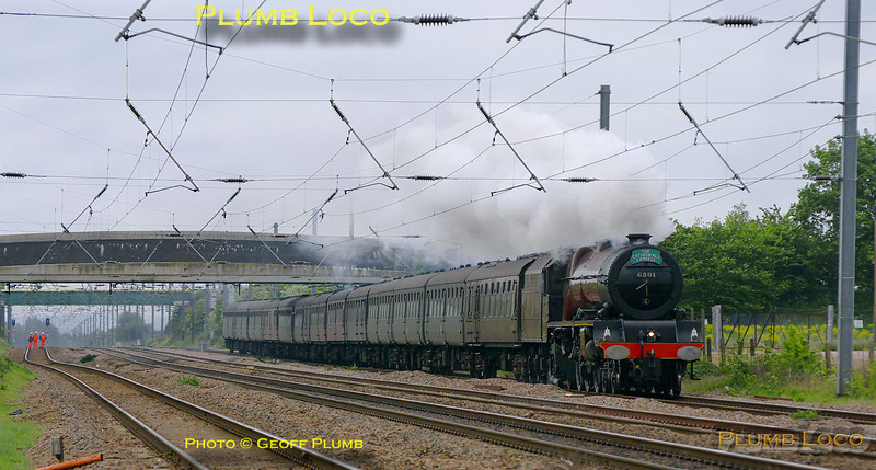 """Stanier """"Princess Royal"""" class 8P 4-6-2 No. 6201 """"Princess Elizabeth"""" heads north at Langford with 1Z72, """"The Cathedrals Express"""", the 09:24 from King's Cross to York and return. The train was running a few minutes late at 10:27 on Thursday 28th April 2011. The framing of this shot was somewhat compromised by the presence of a signal engineer up a signal post just out of the right of the picture! Photo taken from a public footpath across the line. Digital Image No. GMPI8826."""