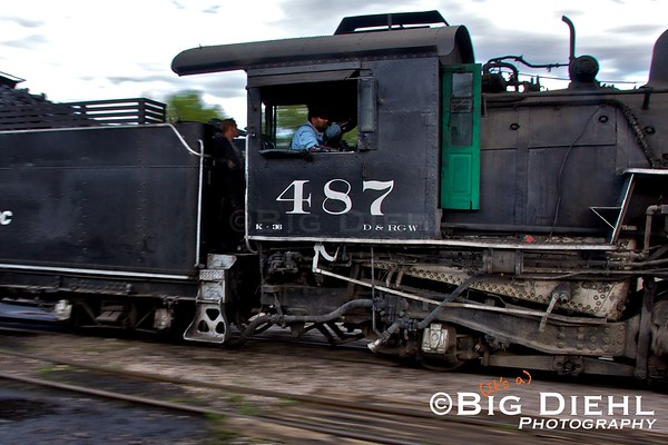 Engineer Jose Torres is at the throttle as he takes eighty six year 487 through the yard.
