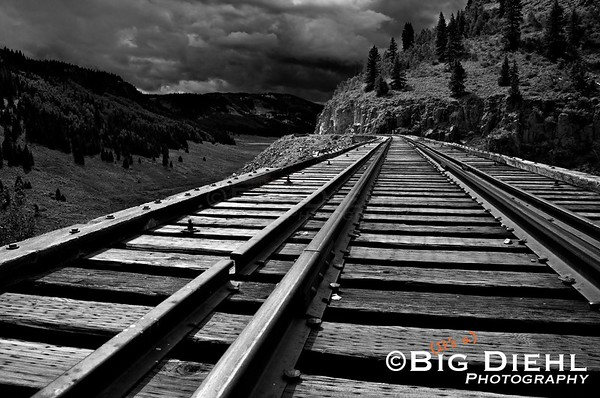 Cascade Creek Trestle Deck.  A late summer thunderstorm overtakes the horizon and will be in our location shortly.  The bluff right above the track is where our earlier photos were taken.