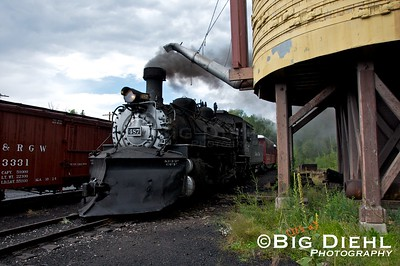 The daily train from Antonito is seen entering the Chama Yard after crossing the Chama River and is now passing under the watertank.