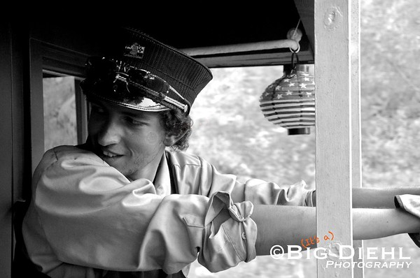 Brakeman Zack Blea, a third generation railroader on the Cumbres and Toltec, rides the rear platform of the caboose on July 4th. ©2010 William Diehl