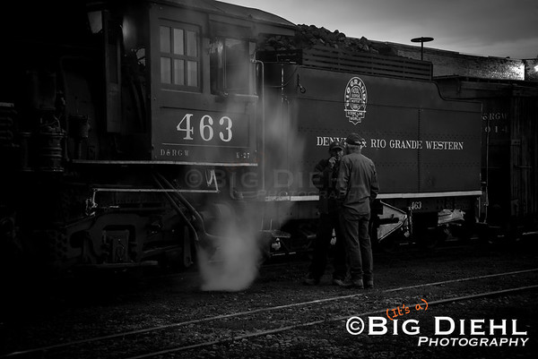 Locomotive engineer Soni Honegger of the C&TS speaks with an unnamed shop employee before departure.