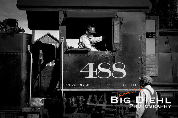 488's engineer keeps an eye on Switchman Zack as Fireman Tracy grabs another shovelful of coal.