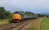 37402 Tails the 08.42 Carlisle-Barrow passed Salthouse on Wed,20th July 2016.