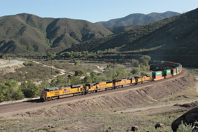 UP8484 (SD70ACe), UP 9845 (SD50M) Ex D&RGW 5501, UP 3911 (SD70M) & UP 8324 (SD70ACe) head a doublestack train on BNSF metals heading for Barstow and the Salt Lake route. 07/05/2007.