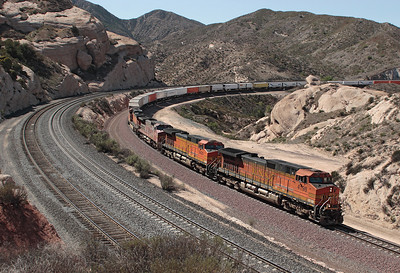 BNSF 4198, BNSF 5425 (both C44-9W's), BNSF 900 (C40-8W) & BNSF 4320 (C44-9W) round Sullivan's Curve with a westbound intermodal train. The two lines in the foreground are the UP Palmdale cutoff main and siding. 07/05/2007.