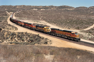 BNSF 5383 (C44-9W), BNSF 2845 (GP39-2), BNSF 963 & BNSF 4486 (both C44-9W's) pass Hill 582 heading downhill with a westbound manifest train. 07/05/2007.