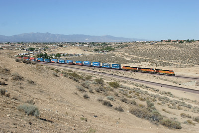 BNSF 4541, BNSF 4067 & BNSF 4307 (all C44-9W's) at Frost crossover with an eastbound doublestack train. 07/05/2007.