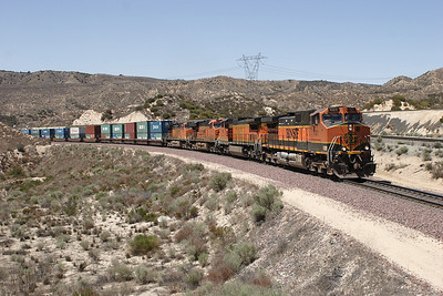 BNSF 1121 (C44-9W), BNSF 919 (C40-8W), BNSF 7616 (ES44DC) & BNSF (C44-9W) head for the summit with an eastbound doublestack train passing Summit Island. 07/05/2007.