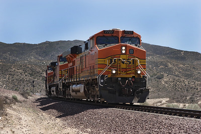 BNSF 7727 (ES44DC), BNSF 4951, BNSF 5272 & BNSF 712 (all C44-9W's) have just come over the summit and are heading downhill past Summit Island with a westbound doublestack/intermodal train which also had some business cars tacked on the back. 07/05/2007.