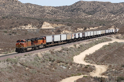 BNSF 4952 (C44-9W) & BNSF 7638 (ES44DC) drop downhill near Hill 582 with a westbound intermodal train. The train is decending what is normally the uphill track. The UP Palmdale cutoff can be seen above the locomotives. 07/05/2007.