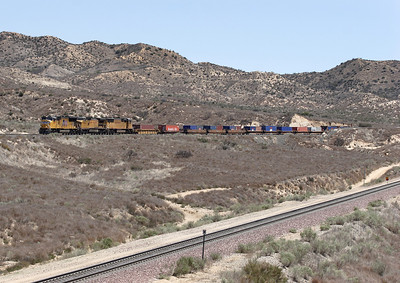 UP 4751 (SD70M), UP 9464 (C41-8) & UP 4075 (SD70M) drop down the Palmdale cutoff with a westbound stack train with just a single layer of containers. The BNSF uphill track is in the foreground. 07/05/2007.