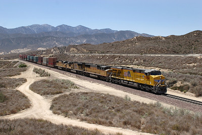 UP 7654 (ES44AC), UP 2396 (SD60M), UP 5150 & UP 4217 (both SD70M's) pass Hill 582 with an eastbound doublestack train. The train is on BNSF rails and will continue to Barstow before taking the Salt KLake Route. 07/05/2007.