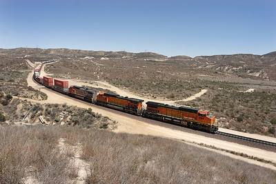BNSF 884 (C40-8W), BNSF 4117 (C44-9W) & BNSF 912 (C40-8W) head a westbound doublestack/intermodal train downhill past Hill 582. 07/05/2007.