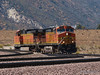 BNSF 4667 comes down off the grade from Cajon pass to pick up the next train.