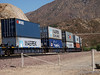 Double stack Container cars fill out this train in the Cajon pass.