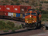 BNSF 4536 heads a sting of containers down the Cajon pass in San Bernardino County.