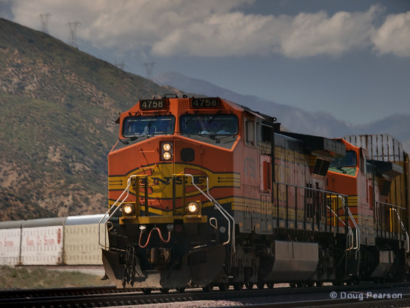 BNSF 4758 heads down past Devore after negotiating Cajon pass.