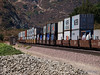 A train load of containers in Cajon pass.