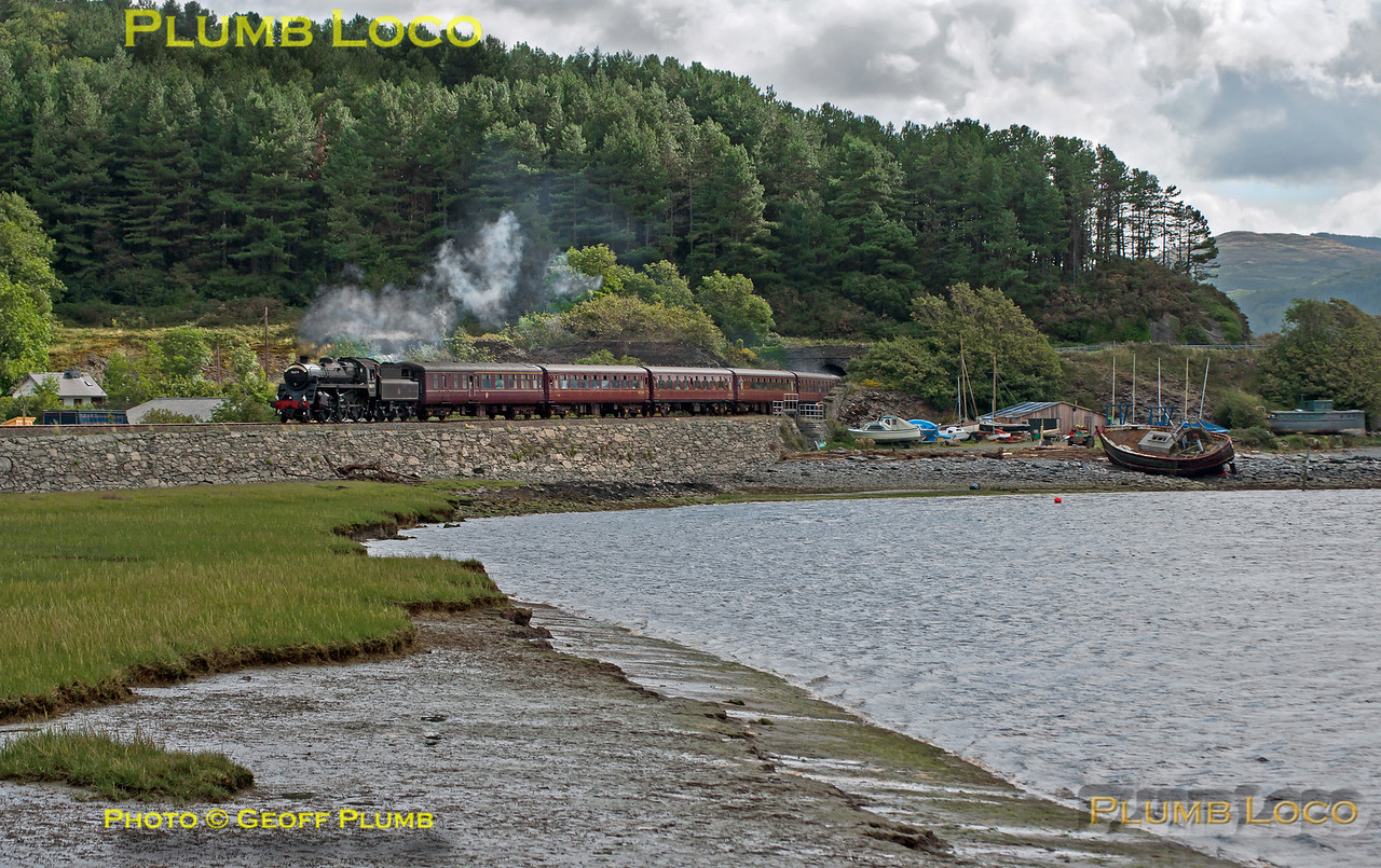 """BR Standard 4MT 2-6-0 No. 76079 exits the short tunnel at Frongoch and passes the boatyard on the estuary of the Afon Dyfi, between Dovey Junction and Aberdovey. It is working 1J77, """"The Cambrian"""", 10:04 from Machynlleth to Porthmadog, 10:18, Tuesday 25th August 2009. Digital Image No. GMPI2802."""