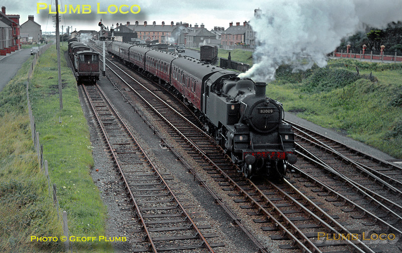 """BR Standard 3MT 2-6-2T No. 82009 starts the up Pwllheli portion of the """"Cambrian Coast Express"""" away southwards from Tywyn station with six coaches in tow, whilst in the down siding is 2-6-4T No. 80105 with the pick-up goods bound for Pwllheli, once the road is clear. Wednesday 29th July 1964. Slide No. 873."""