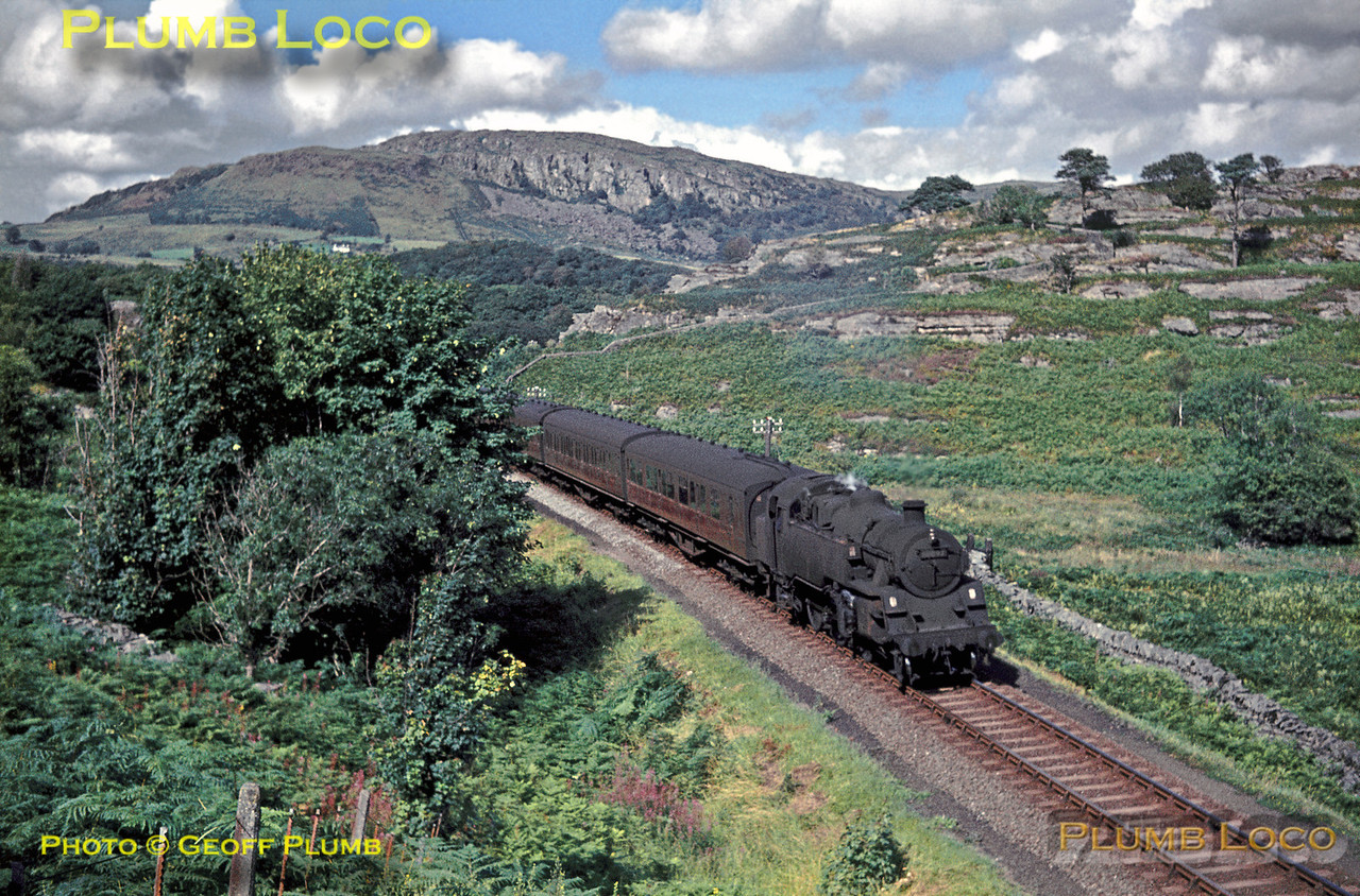 BR Standard 4MT 2-6-4T No. 80097 climbs through the hills between Porthmadog and Black Rock Sands Halt with the 12:48 stopping train from Aberystwyth to Pwllheli. Saturday 8th August 1964. Slide No. 941.