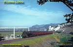 """BR Standard 4MT 4-6-0 No. 75055 is at the head of the up Pwllheli portion of the """"Cambrian Coast Express"""" as it nears Minffordd station. Behind the train is Minffordd Quarry whilst alongside work is in progress to consruct the power lines changeover point from pylons to underground cables to cross the Glaslyn estuary. Friday 27th August 1965. Slide No. 1584."""