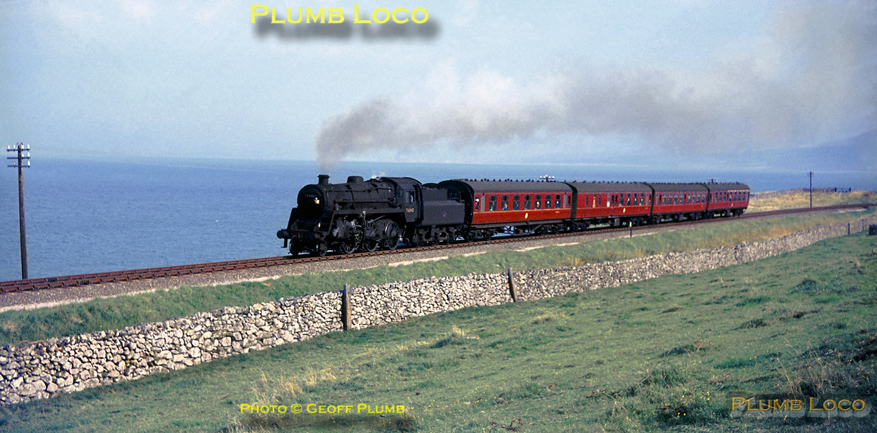"""BR Standard 4MT 2-6-0 No. 76040 hauls the up """"Cambrian Coast Express"""" along the coastline between Friog Cliffs & Llwyngwril, en route from Pwllheli to Machynlleth. There it will join up with the portion of the train from Aberystwyth before continuing to Shrewsbury, Birmingham and London Paddington. Friday 19th August 1966. Slide No. 2477."""