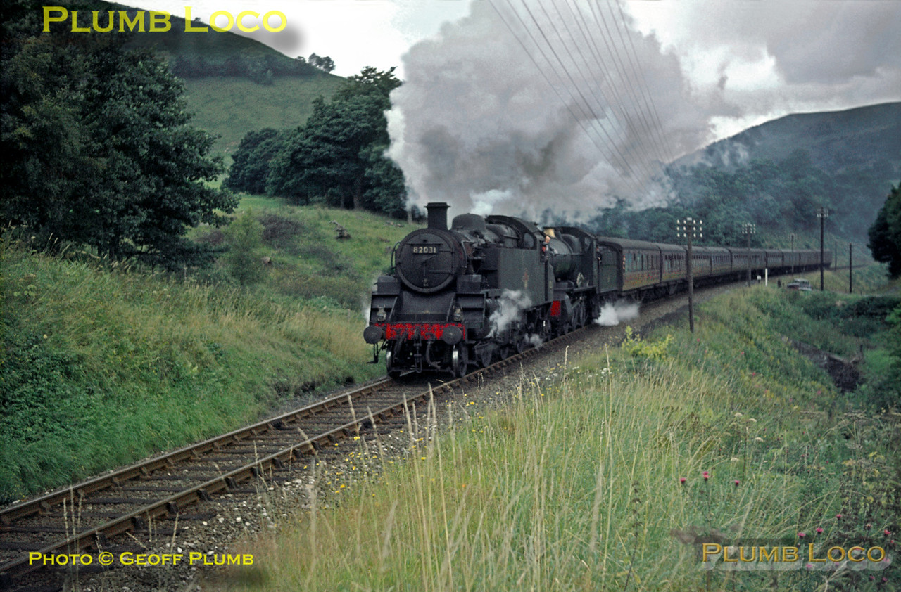 "The up ""Cambrian Coast Express"" is double-headed on the climb to Talerddig by BR Standard 3MT 2-6-2T No. 82031 and GWR ""Manor"" class 4-6-0 No. 7819 ""Hinton Manor"". The train ran in two portions, one from Pwllheli and one from Aberystwyth, combining at Machynlleth for the remainder of the journey to Paddington. Here, it is loaded to ten coaches and ""Manors"" were limited to eight over Talerddig, hence the pilot loco. Saturday 31st August 1963. Slide No. 351."