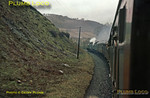 """The """"Festiniog Railway Society"""" special train rounds the curve above the River Dee (Dyfrdwy) between Berwyn and Glyndyfrdwy on the line from Ruabon to Barmouth Junction (Morfa Mawddach). """"Manor"""" class 4-6-0s Nos 7819 """"Hinton Manor"""" & 7827 """"Lydham Manor"""" double head the train over what is now part of the Llangollen Railway as they make their way to Porthmadog on a very wet Saturday 20th April 1963. Slide No. 7."""