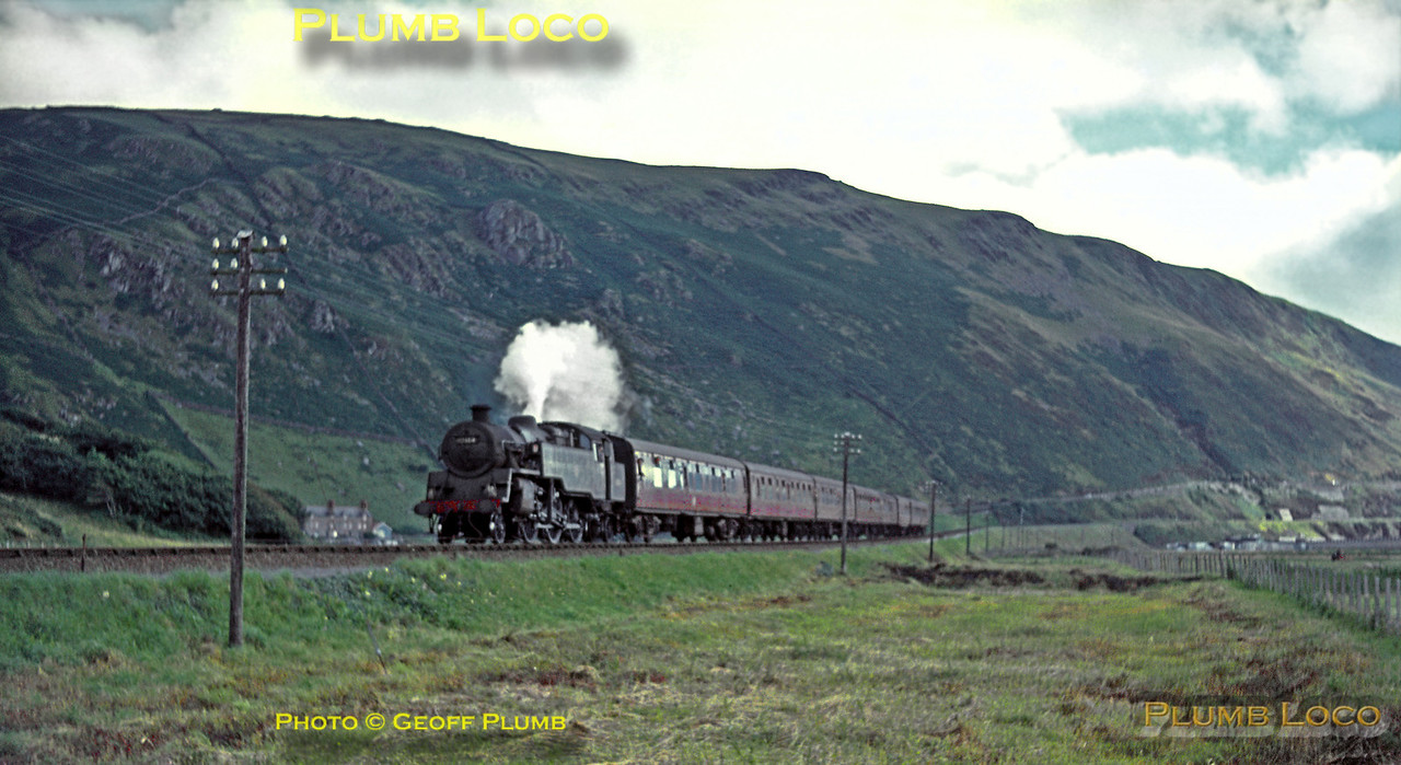 """BR Standard 4MT 2-6-4T No. 80106 blows off steam as it descends from Friog cliffs towards Fairbourne station as it heads the down Pwllheli portion of the """"Cambrian Coast Express"""" which it has worked from Machynlleth. Wednesday 29th July 1964. Slide No. 885."""