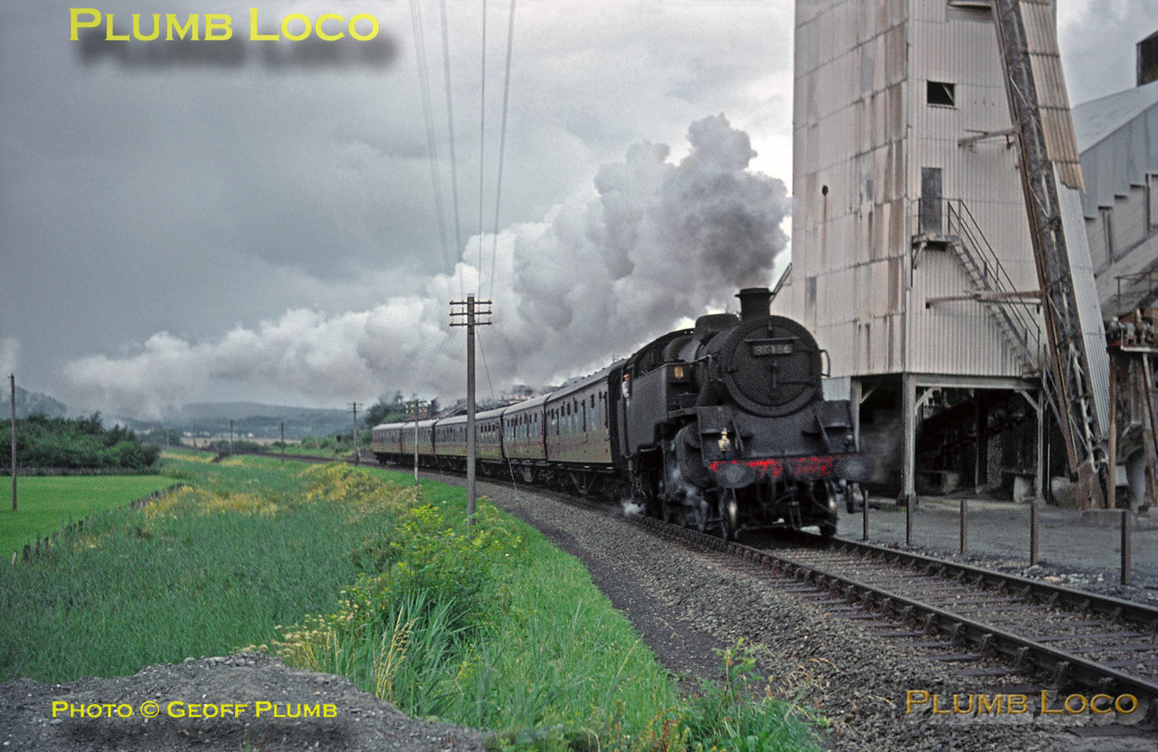 On a lovely summer day (!), BR Standard 4MT 2-6-4T No. 80136 passes Minffordd Quarry with the summer  Saturdays Only 07:20 from Pwllheli to Paddington express. Saturday 8th August 1964. Slide No. 934.