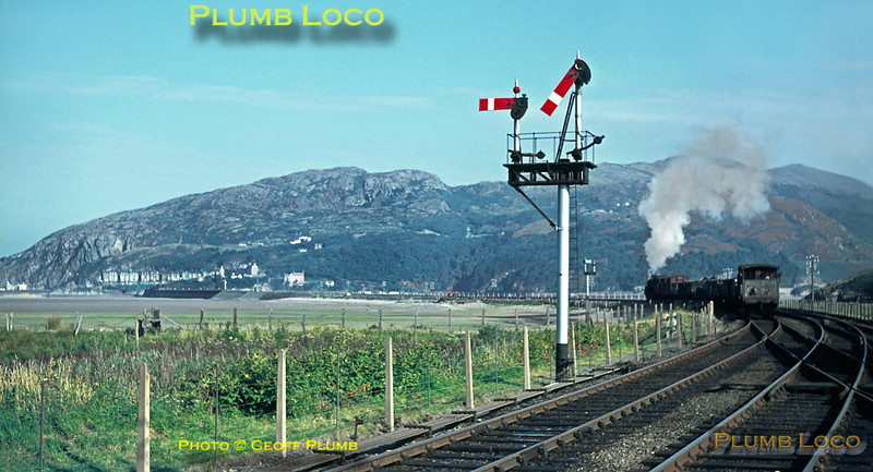 """Having crossed the up """"Cambrian Coast Express"""" at Morfa Mawddach station, 75009 has now set off towards Barmouth with the down daily goods train from Machylleth to Pwllheli on the lovely morning of Monday 22nd August 1966. Slide No. 2489."""