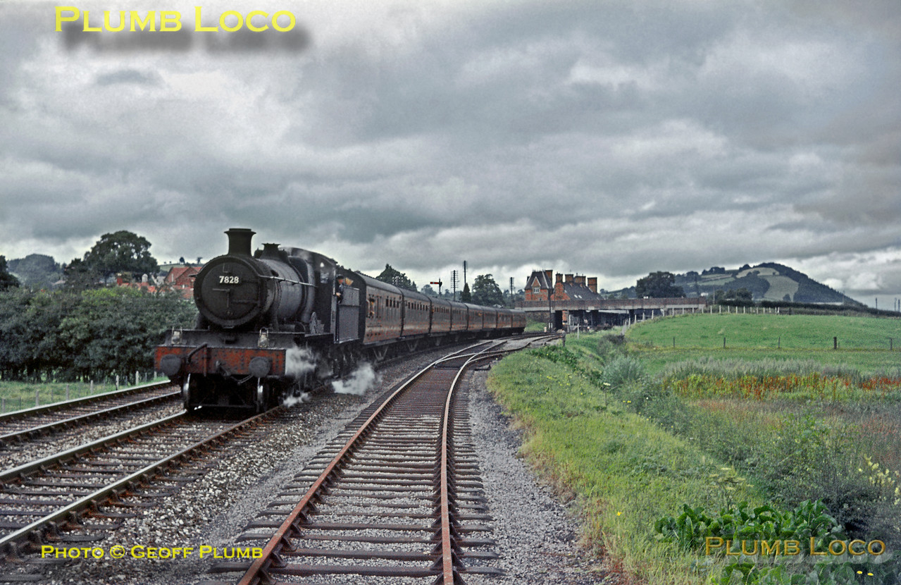 """""""Manor"""" Class 4-6-0 No. 7828 """"Odney Manor"""" starts away from the stop at Welshpool with its eight coach train, the 09:10 from Paddington to Aberystwyth on a rather dull Saturday 25th July 1964. Slide No. 817."""