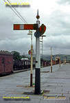 A delightful lower quadrant semaphore signal is the up starter from platform 2 at Aberystwyth station, the signal box in the background. There still seems to be plenty of non-passenger traffic around at this time in August 1966. Slide No. 2458.