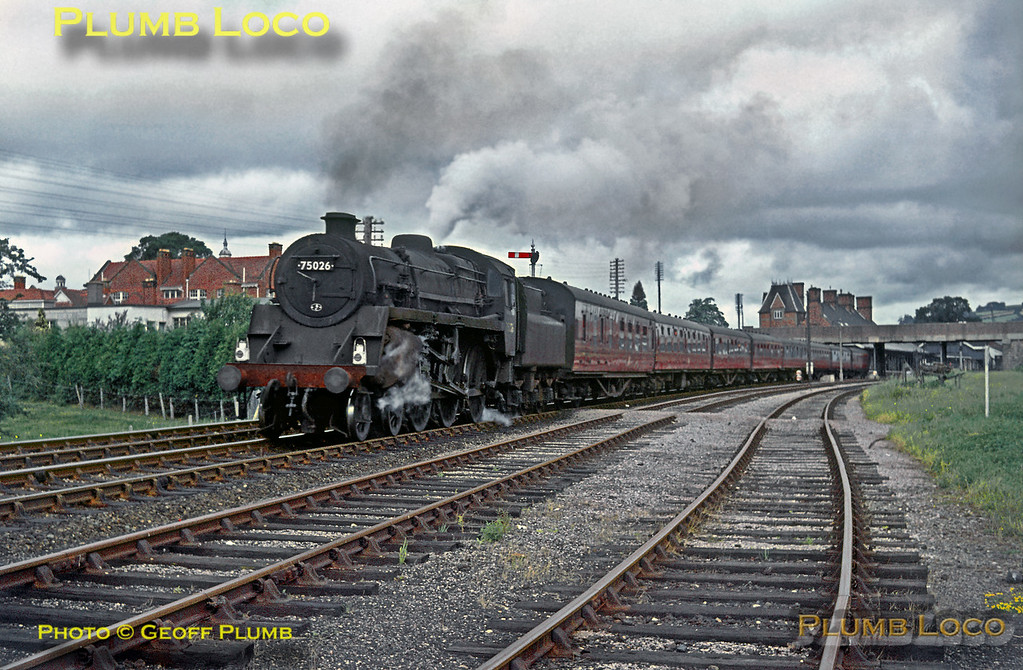 Double-chimneyed BR Standard 4MT 4-6-0 No. 75026 starts away from Welshpool station with the eight-coach 08:20 train from Paddington to Aberystwyth on Saturday 25th July 1964. Slide No. 815.