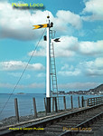 Two fixed distant signals share the same post at the southern end of Barmouth Bridge. Facing the camera is the distant for Barmouth whilst that for Morfa Mawddach has its back to the camera. The finial adorning the top also has its orb painted yellow as it has distants only on the post. Monday 22nd August 1966. Slide No. 2490.
