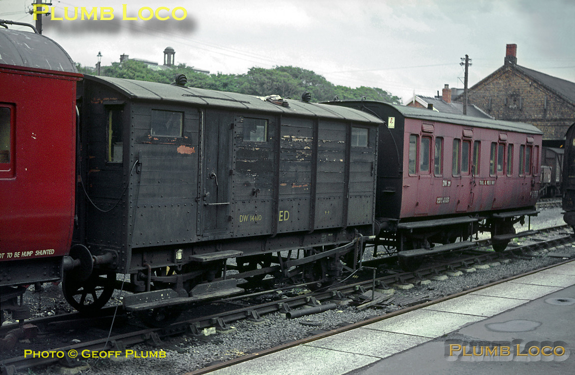 A couple of ancient vehicles form a part of a departmental train in the sidings at Aberystwyth station, No. DW14610 is presumably some sort of brake or Guard's van while DW29 is a converted four-wheel carriage, now a Tool & Mess Van. August 1966. Slide No. 2459.