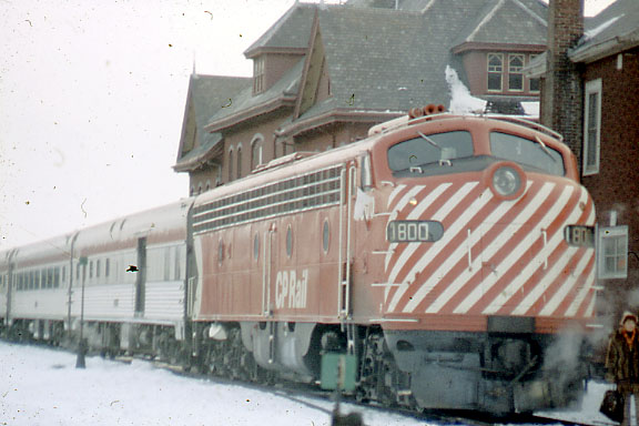 3/23/1974 - Fan Trip from Montreal to Wells River, VT pauses at the station at St. Johnsbury, VT. This trip was advertised as an RDC trip but happily E-8 locomotive number 1800 and six coaches were substituted for the RDC's.