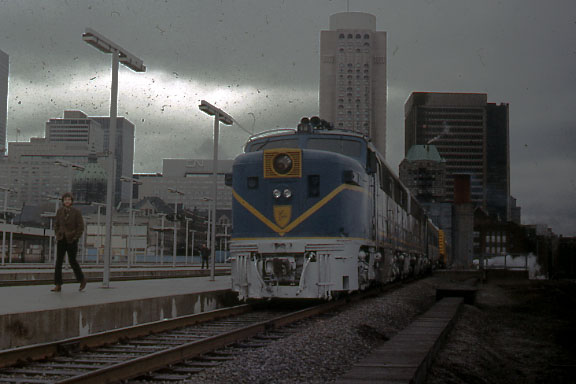In 1973 the Delaware and Hudson RR sent a special train to Montreal with exhibits. The train was powered by 2 of the D+H's famous Alco PA passenger engines. The location is Canadian Pacific's Windsor Station. Photo was taken on Sunday so the station is empty of commuter trains.