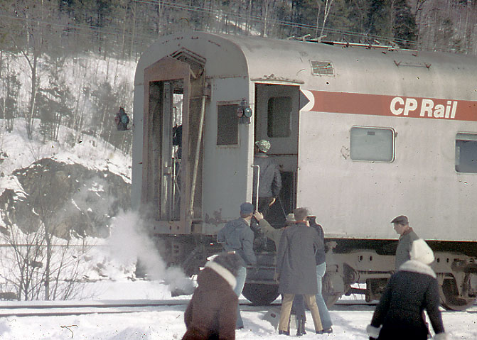 Railfan trip from Montreal to Vermont on 3/23/74. Passengers are boarding after a photo stop. Note the oil markers and the steam heat.