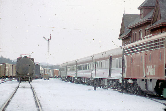 3/23/74 Fan trip from Montreal at St. Johnsbury Depot. The first 3 cars were Budd built cars normally assigned to the Canadian. The last 3 were CP home built cars from Angus Shops,