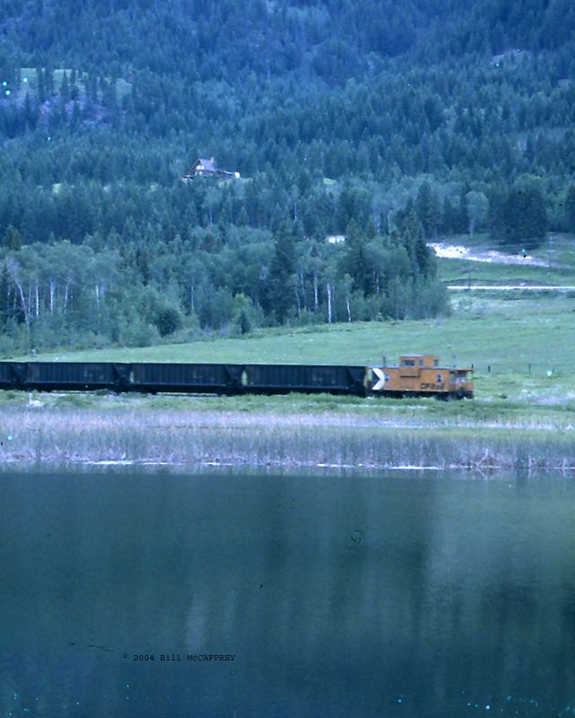 CP Caboose on Coal Train across water copy