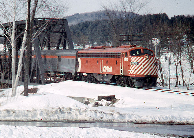 1974 fan trip from Montreal to Wells River, VT hauled by CPR E-8  passenger diesel number 1800 near Barnet, VT