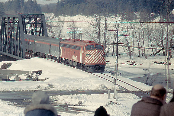 Near Barnet, Vermont 3/23/1974 . . . Photo line of railfans riding extra train to Wells River, VT taking advantage of runby over bridge