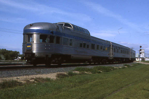 """Via Rail Canada Train Number 1, """"The Canadian"""" running across the prairie. VIA blue has replaced CP red but the train is running on CP rails."""