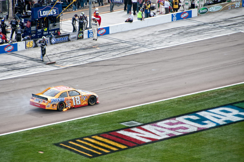 The end of the race for # 18, Kyle Busch, after a blown engine in the back straight.
