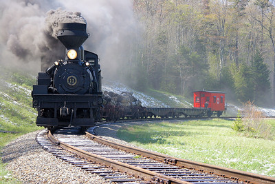 Shay steam locomotive lettered as Mower Lumber #11 on a photo runby.