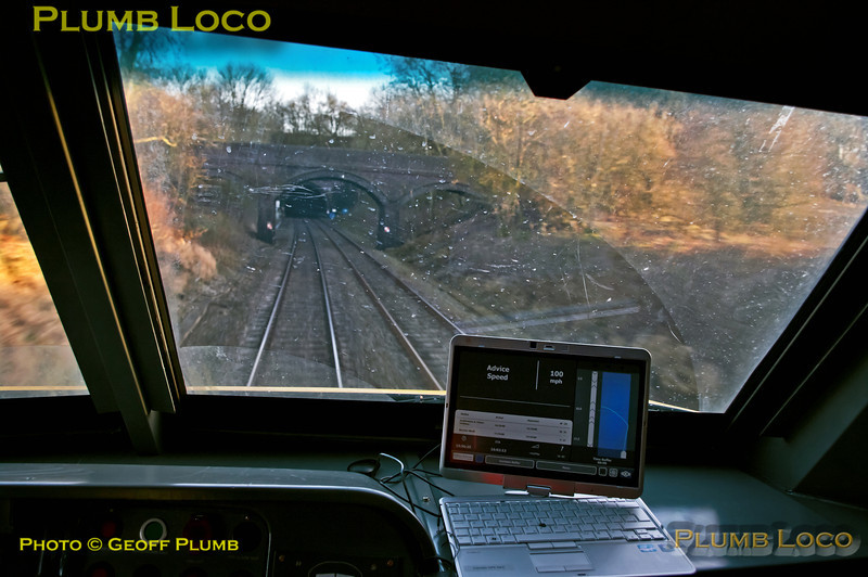 At 15:56:25 test train 5H48 is about to enter Ardley Tunnel as it heads for its next stop at Bicester North. The Advice speed from the DAS is 100mph and the pointer in the right of the screen is very slightly ahead of the acceleration curve, 100mph has still yet to be reached on the gradient of +4.65%. Very soon after it should be reached then braking is advised to start for the stop at Bicester North, scheduled for 15:59. The ETA for Bicester is shown as 16:02:13 so a little  more time has been lost. Sunday 27th January 2013. Digital Image No. GMPI14166.