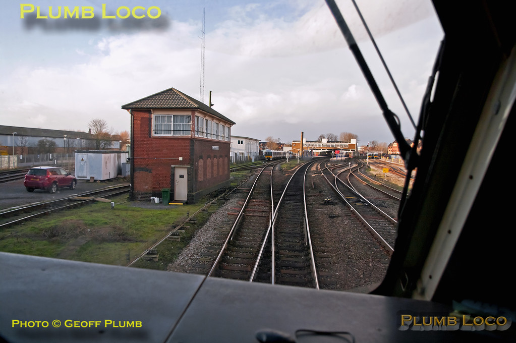 View from the cab of 67015 as test train 5U41 approaches its destination in platform 1 at Banbury station, about to pass Banbury South Signal Box at 15:23:10 on Sunday 27th January 2013. Digital Image No. GMPI14126.